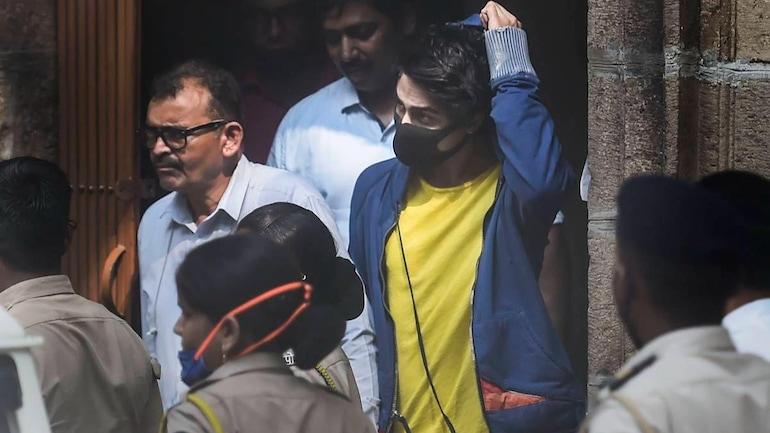 Aryan Khan (in yellow shirt, blue jacket) taken to court by police